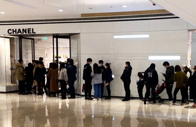People are queuing again to shop in Chanel in Shanghai's Plaza 66 as the outbreak is contained in China.