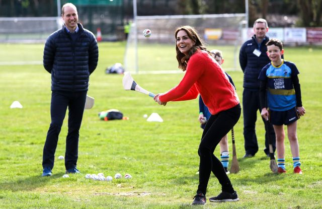 Kate Catherine Duchess of Cambridge, center, gestures as she tries hurling next to Britain's Prince William at Salthill Knocknacarra GAA Club in Galway, Ireland,. The Duke and Catherine Duchess of Cambridge visit Galway on the last of a three-day official visit to IrelandIreland Royals, Galway - 05 Mar 2020