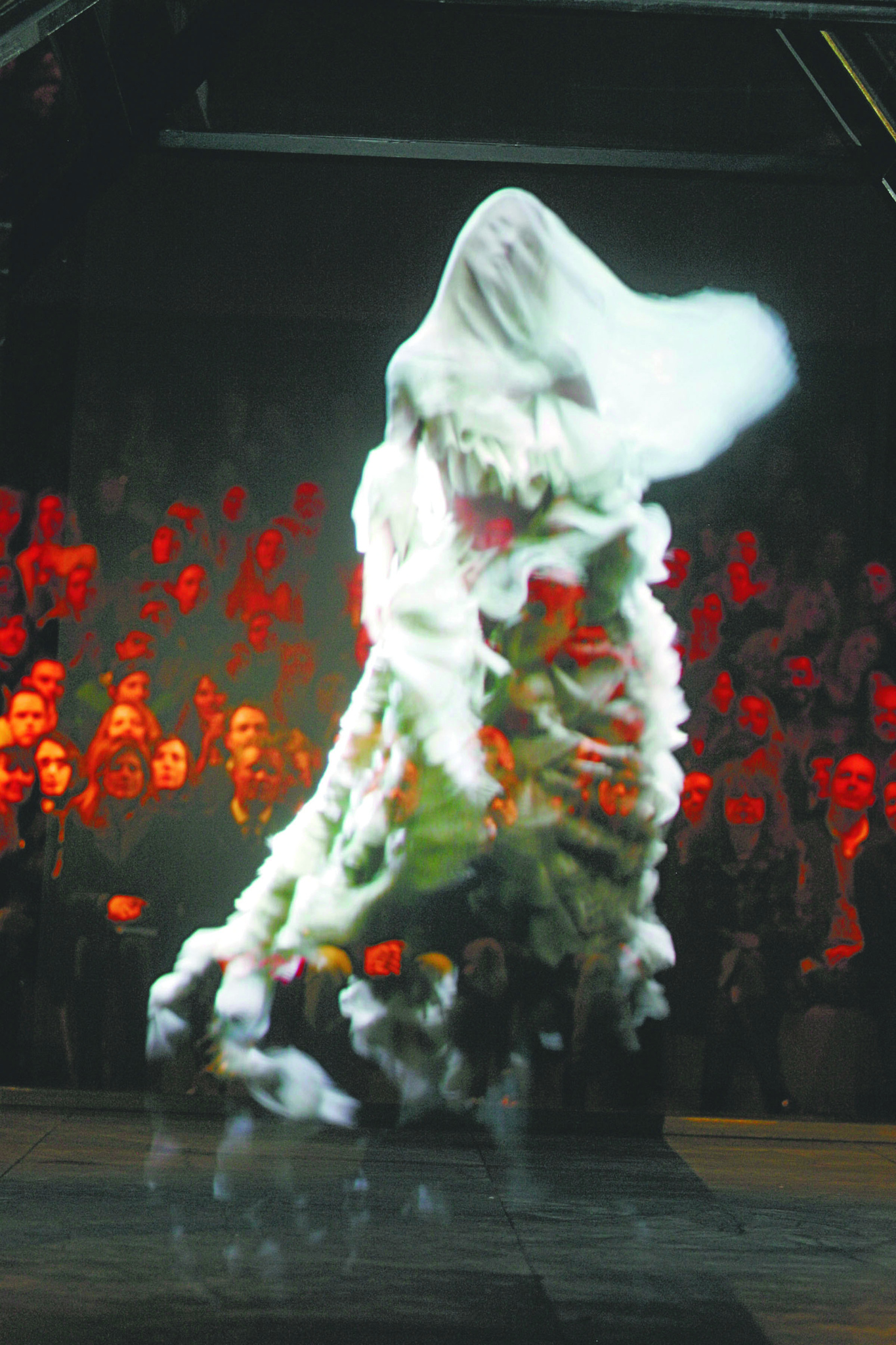 Model Kate Moss as a hologram on the runway during Alexander McQueen fall 2006 show