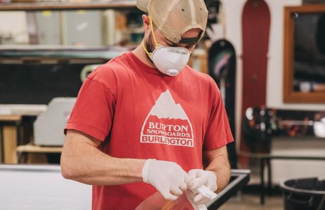 A Burton worker creates face shields.