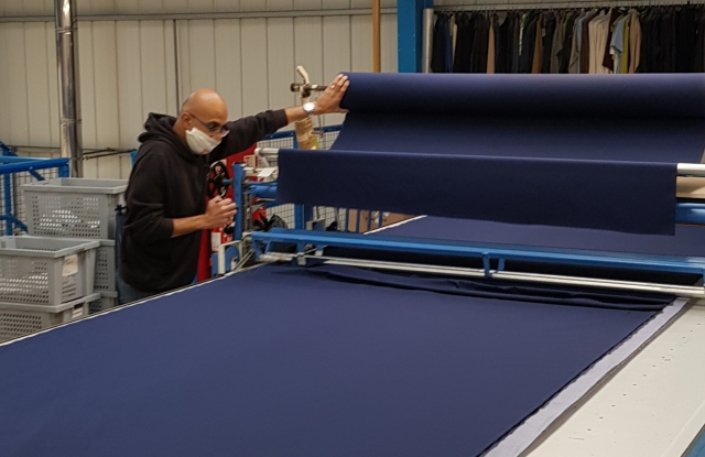 Prepping fabric for NHS scrubs at the E. Tautz factory in northern England.