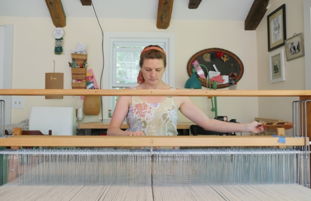 A weaver at work on the Connecticut-sourced project.