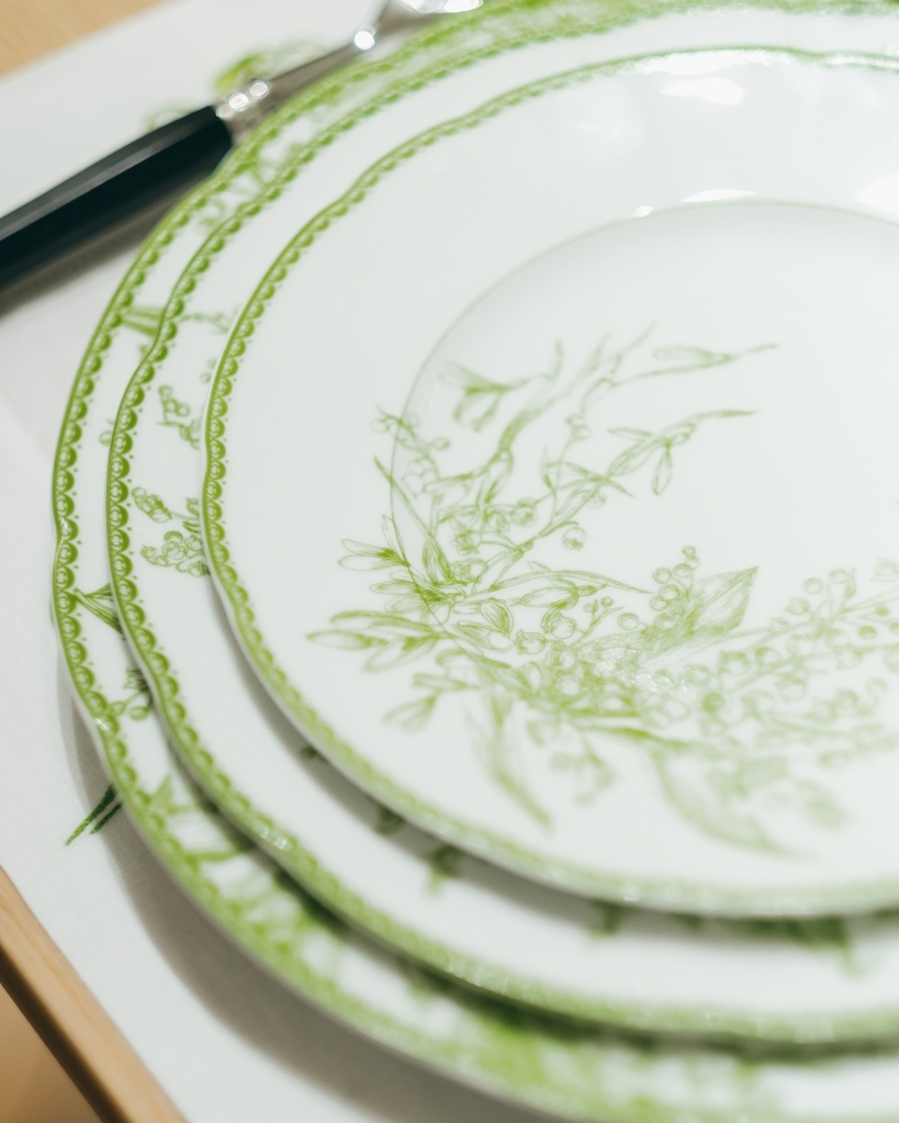 Dior Maison's new porcelain dinner ware features a lily of the valley motif.