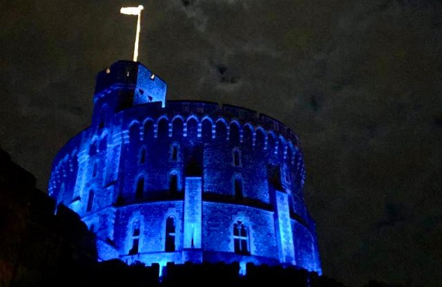 The Round Tower at Windsor Castle lit up in blue as a tribute to the NHS