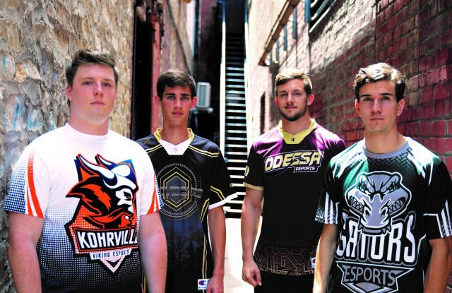 Four e-sports players wearing special Champion jerseys and tops.