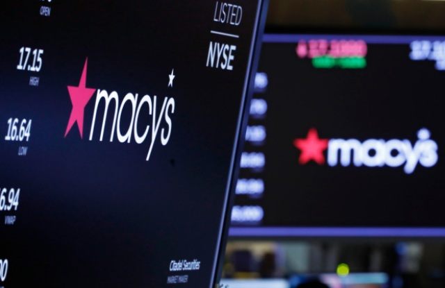 The logo for Macy's appears above posts on the floor of the New York Stock Exchange, . Macy's rose 2.9 percent after the department store giant said it will cut 2,000 corporate jobs and close 125 of its least productive storesFinancial Markets Wall Street Macy's, New York, USA - 05 Feb 2020