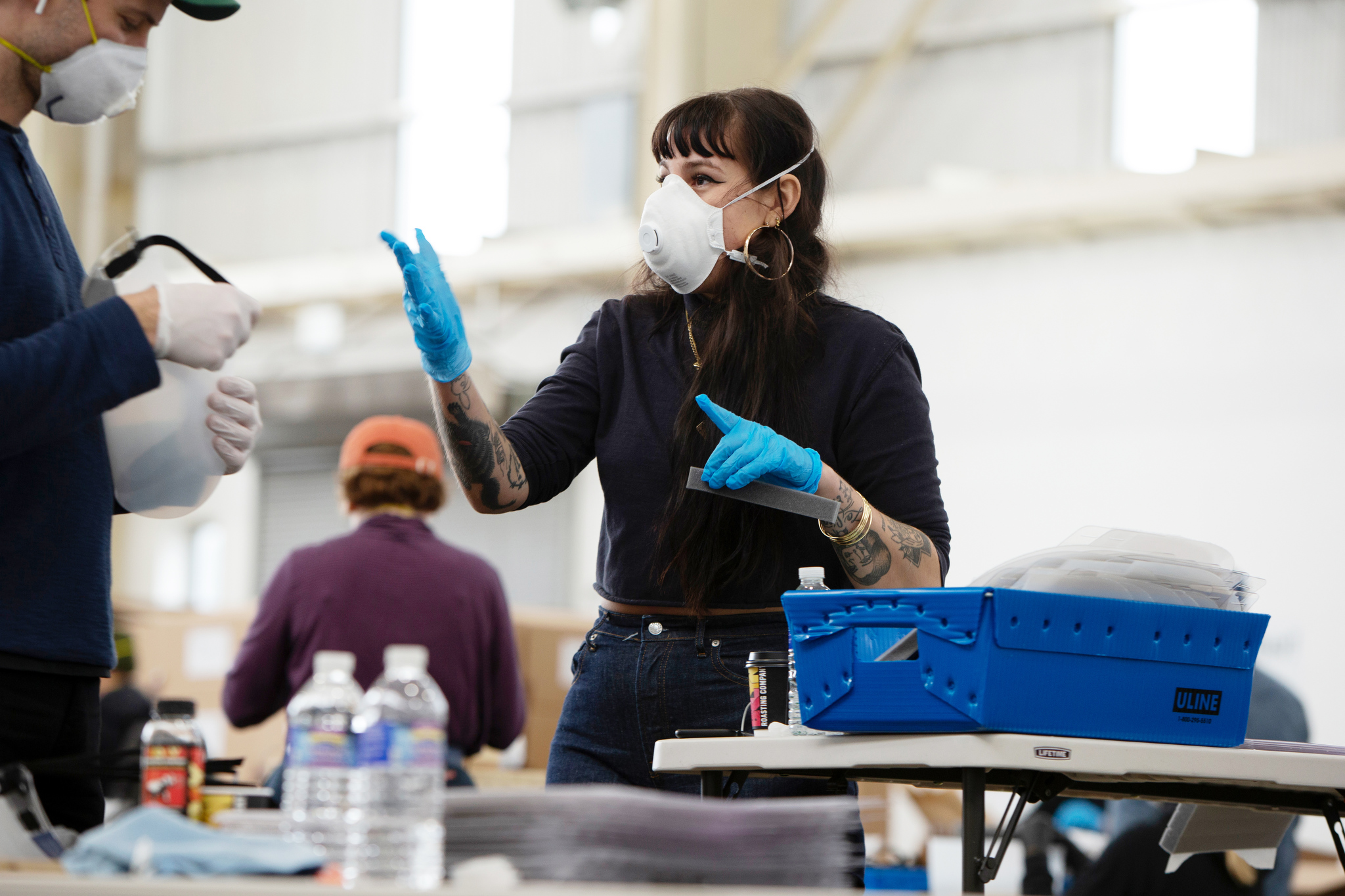 Workers from Bednark Studio and Duggal Visual Solutions are part of a group effort making face shields in The Brooklyn Navy Yard.