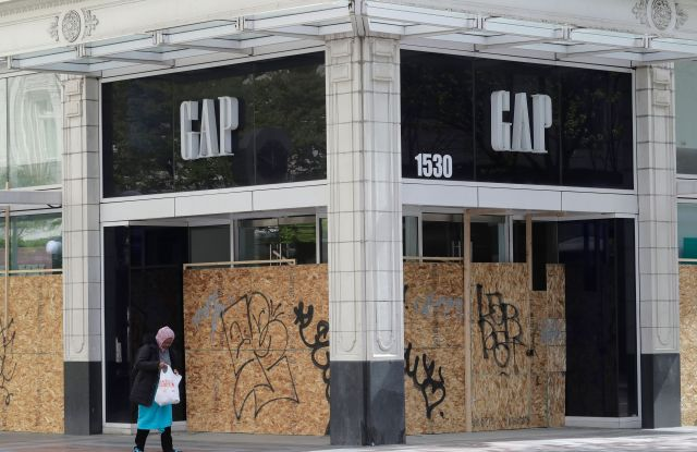 boarded up gap store closed