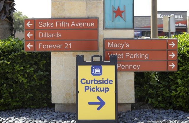 Sign directs shoppers to curbside pickup at North Star Mall in San Antonio, . Some retail stores are beginning to reopen Friday after weeks of closure due to the COVID-19 pandemicVirus Outbreak Texas, San Antonio, United States - 24 Apr 2020