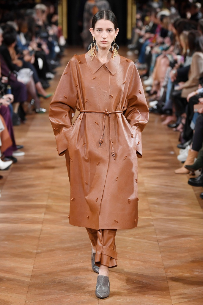 Stella McCartney uses vegan leather for ready-to-wear, such as this fall 2020 coat, and for a vibrant accessories range that includes the signature Falabella handbag.
