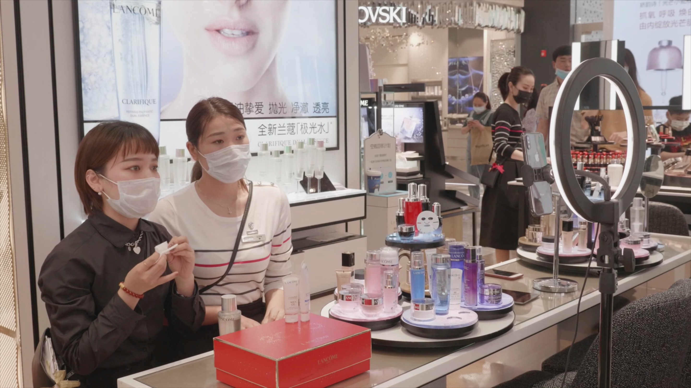 Live streaming played a vital role in keeping business afloat for Intime during the Coronavirus outbreak in China. Here, two live streamers showcased beauty products at Lancôme's counter inside an Intime department store.