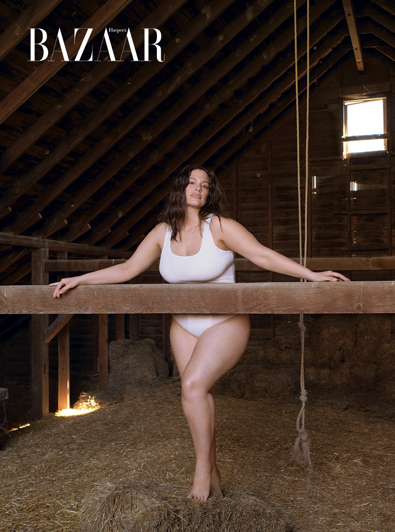 Ashley Graham inside a white house on a hill