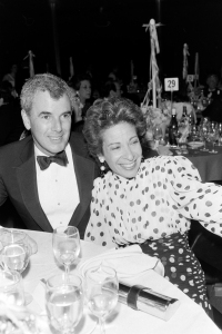 Joan and Richard Raines of Adele Simpson attend the 1986 annual New York Fashion Council dinner-dance held at the American Museum of Natural History.