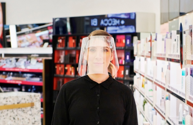 A Mecca Brands retail team member wearing a face shield at the Mecca Highpoint store in Melbourne.