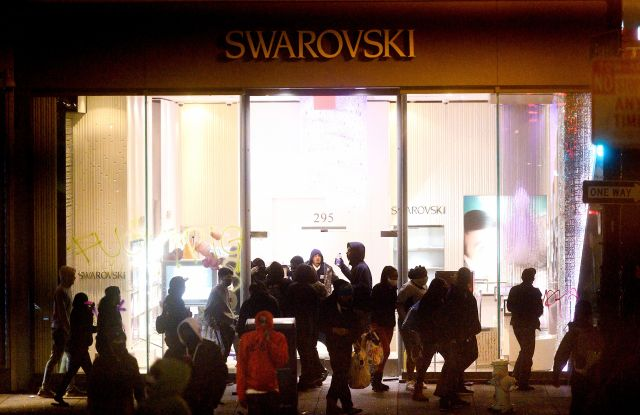 People vandalize a Swarovski store in San Francisco's Union Square.