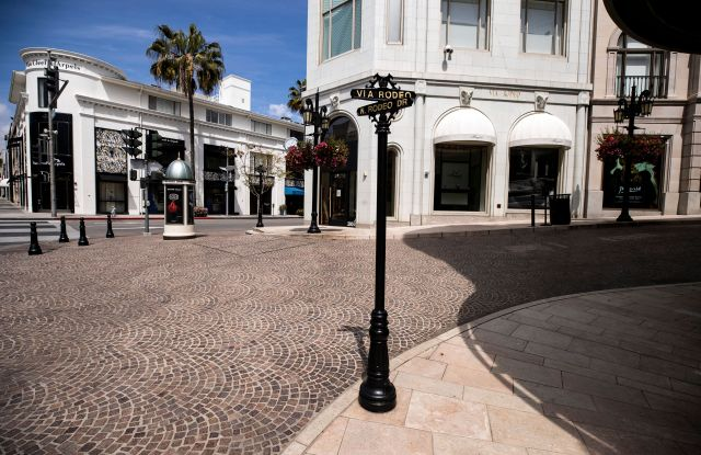 Rodeo Drive is empty and its luxury goods stores are closed amid the coronavirus pandemic in Beverly Hills, California, USA, 28 March 2020.Coronavirus - Covid-19 - Epidemic in Los Angeles, Beverly Hills, USA - 28 Mar 2020