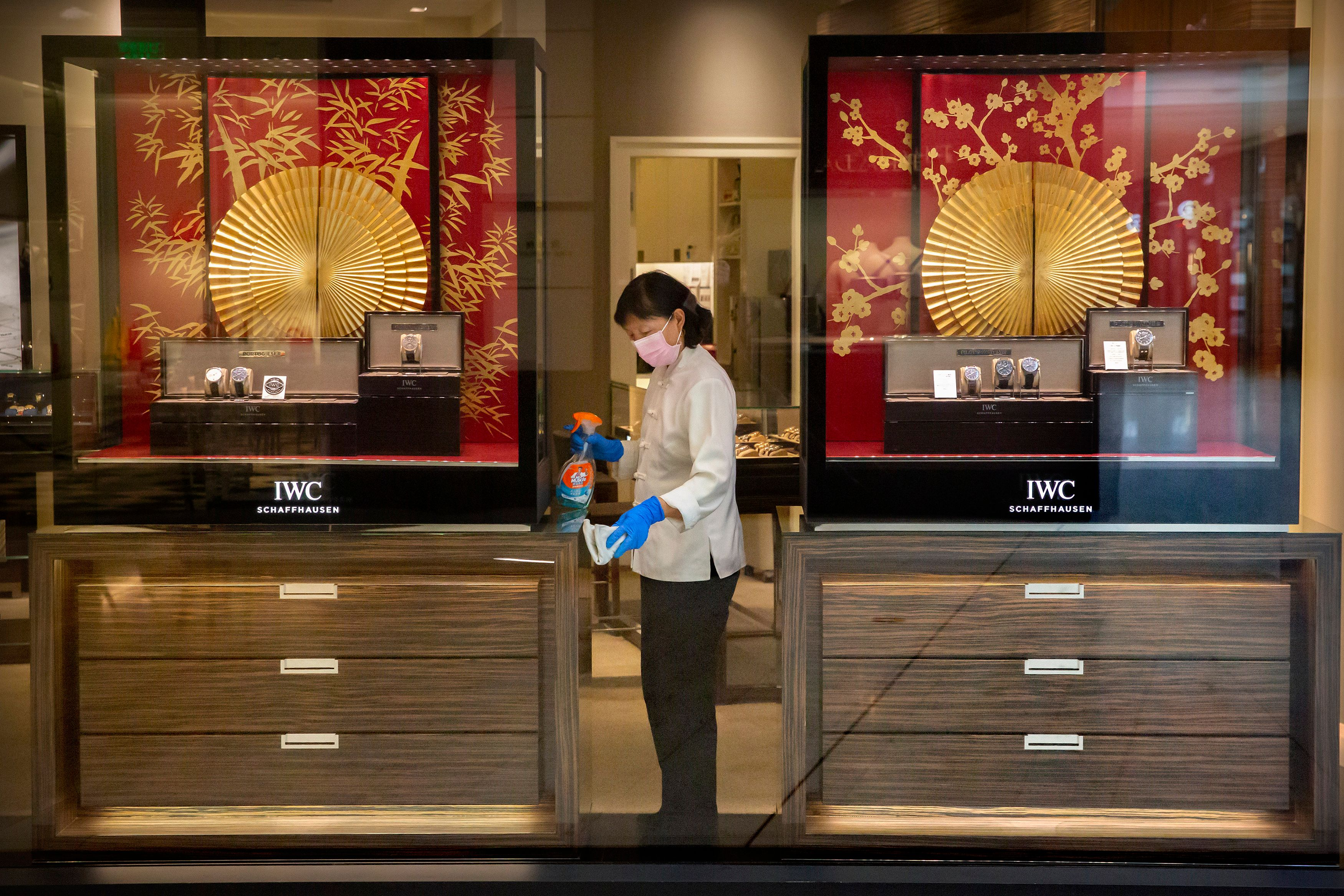 An employee disinfecting an IWC store in Beijing