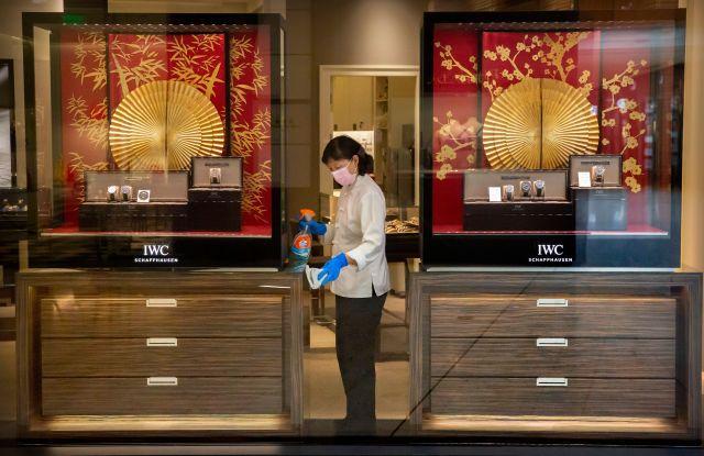 An employee disinfecting an IWC store in Beijing