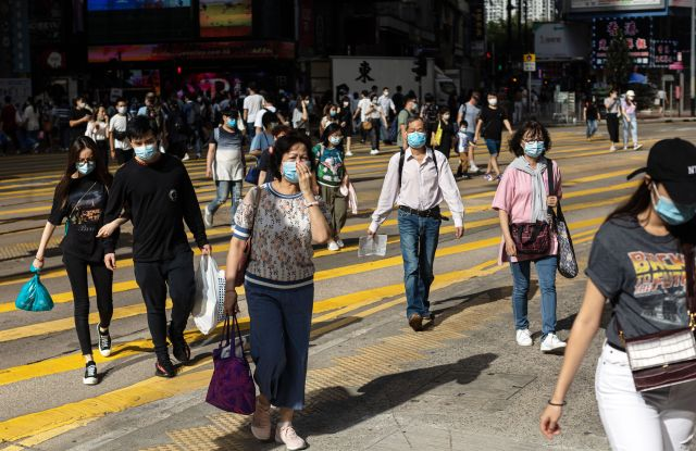 Pedestrians wearing protective face masks cross an intersection on a shopping street in the Causeway Bay district in Hong Kong, China, 05 May 2020, amid the ongoing coronavirus COVID-19 pandemic. From 08 May Hong Kong people will be allowed to go out in groups of up to eight, as a limit on the size of gatherings in public places is relaxed amid a dwindling number of new COVID-19 cases in the city.Coronavirus situation in Hong Kong, China - 05 May 2020