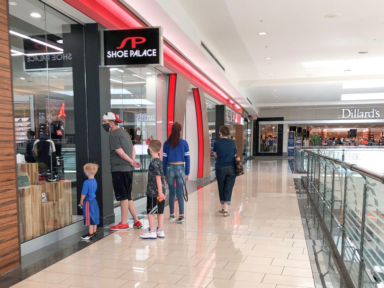 family shoppers masks mall dillard's texas