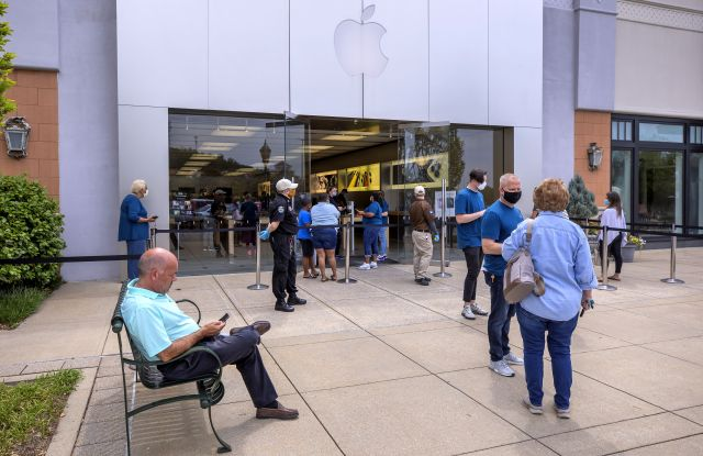 People wait in line to enter a reopened Apple Store at The Summit shopping center in Birmingham, Alabama, USA, 13 May 2020. A handful of Apple's US retail stores are being reopened with strict social distancing guidelines for customers amid the coronavirus COVID-19 pandemic. The spread and containment efforts of the coronavirus COVID-19 pandemic has caused disruptions to daily life across the globe.Apple Store reopening amid the coronavirus COVID-19 pandemic in Birmingham, Alabama., USA - 13 May 2020