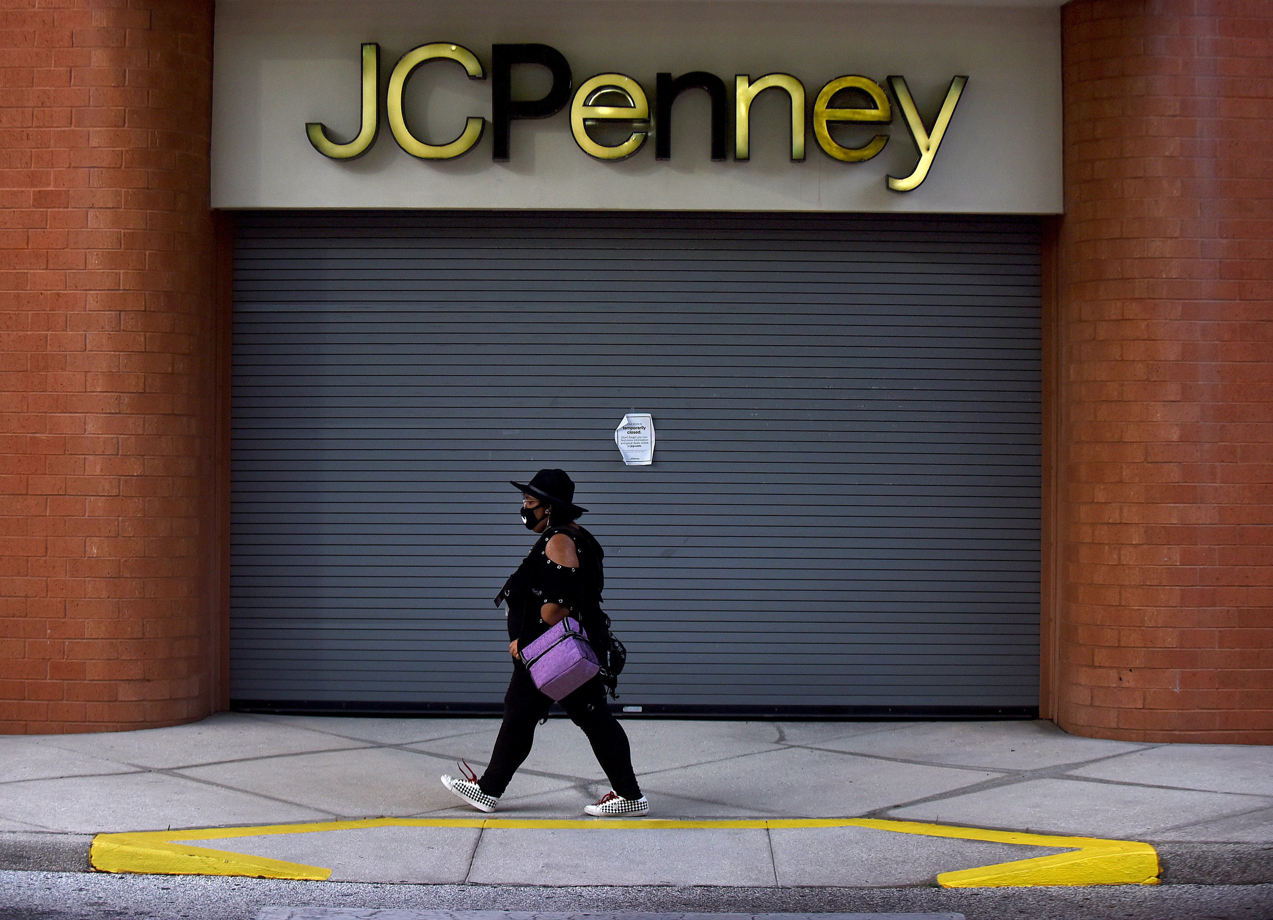 woman walks closed JC Penney mask coronavirusl