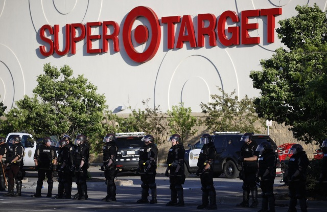 Minnesota State Police protect a Target Store, in St. Paul, Minn. Violent protests over the death of George Floyd, the black man in police custody broke out in Minneapolis for a second straight night Wednesday, with protesters in a standoff with officers outside a police precinct and looting of nearby storesMinneapolis Police Death, St. Paul, United States - 28 May 2020