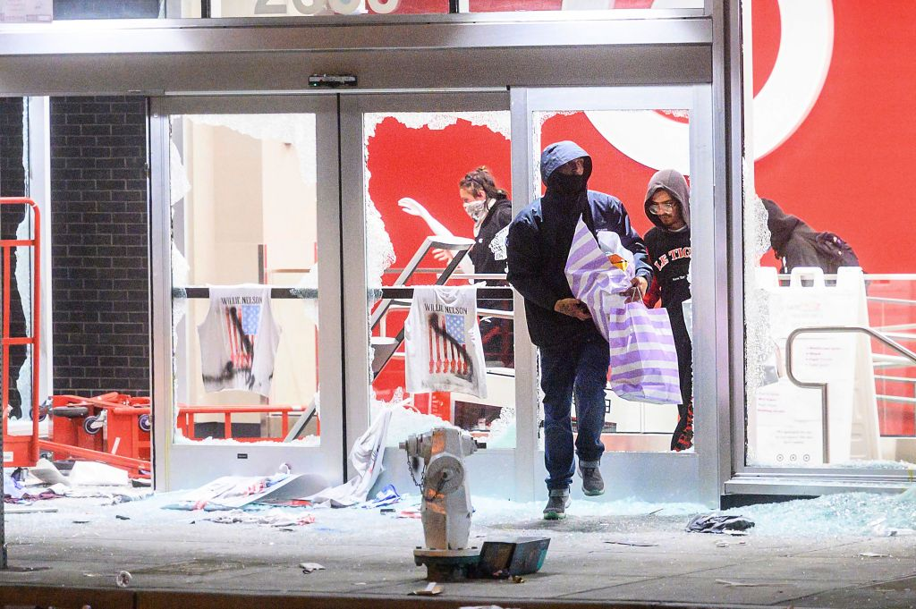 People leave a vandalized Target store in Oakland, Calif.,, during protests against the death of George Floyd, a handcuffed black man in police custody in MinneapolisMinneapolis Police Death , Oakland, United States - 29 May 2020