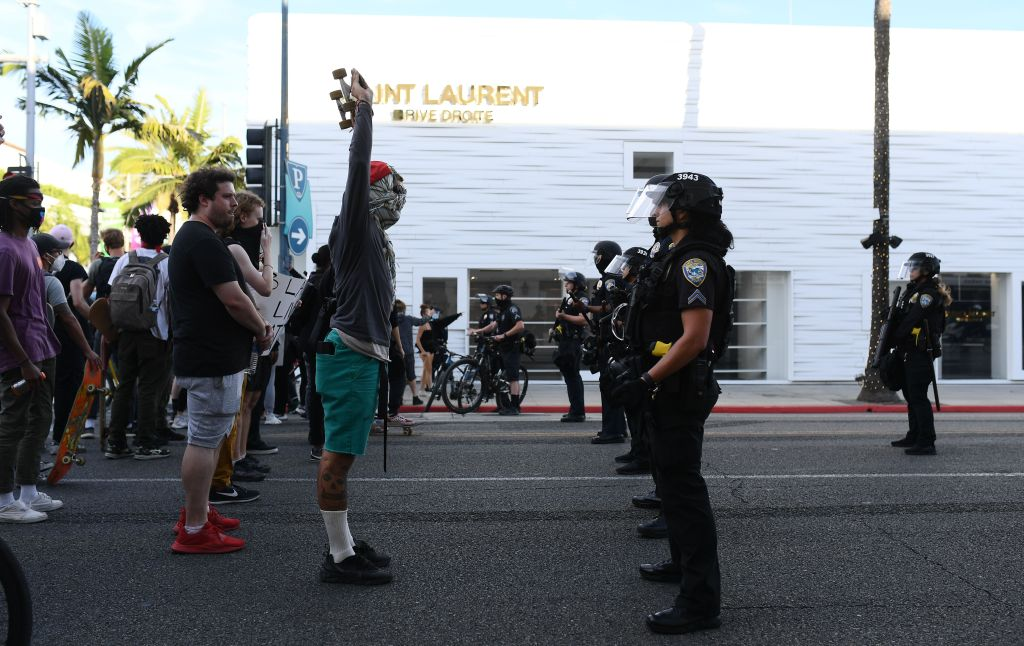 People protest near Rodeo Drive in Beverly Hills, California on May 30, 2020.Black Lives Matter protest, Los Angeles, USA - 30 May 2020