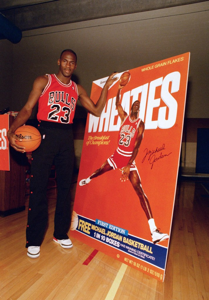 "Chicago Bulls' Michael Jordan poses alongside his likeness on a box of Wheaties during an unveiling ceremony in Chicago, . Jordan is the seventh celebrity athlete to have his image displayed on a box of the cereal marketed as ""The Breakfast of ChampionsBulls Jordan Wheaties 1988, Chicago, USA"