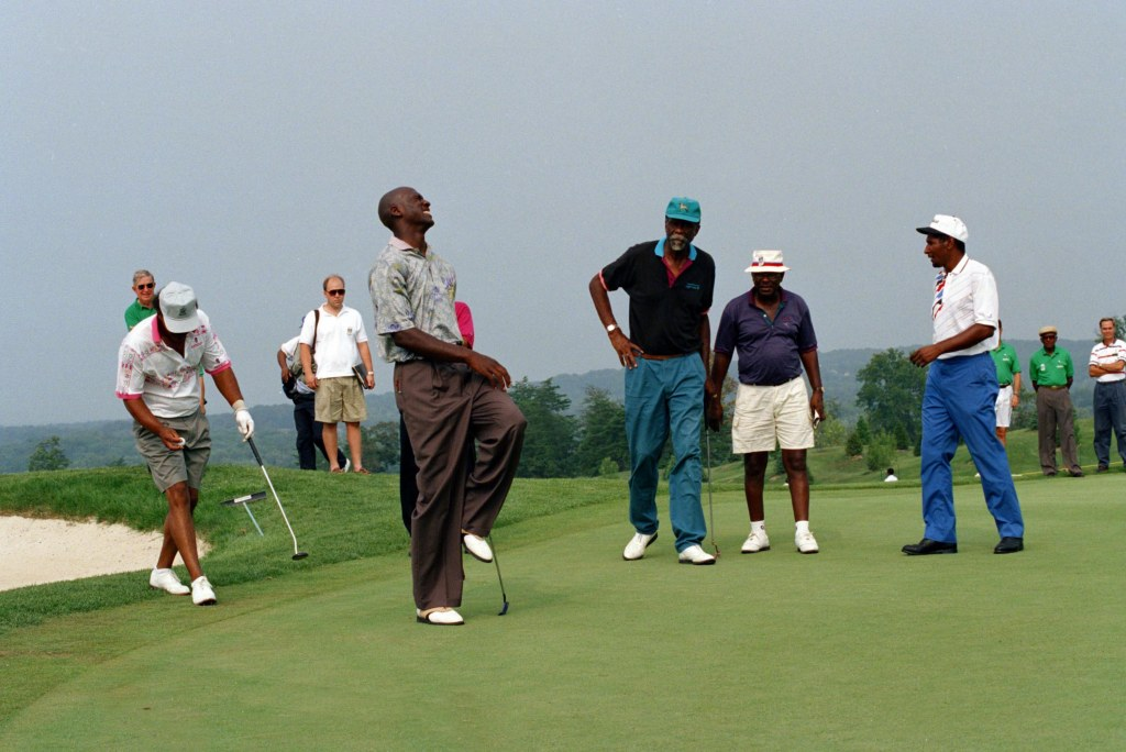 Chicago Bulls' Michael Jordan grimaces after a putt as former Boston Celtic Bill Russell watches during the Rose Elder Invitational celebrity golf tournament in Leesburg, Va., . Jordan's father James was found murdered a week ago in South CarolinaCelebrity Golf Jordan Russell 1993, Leesburg, USA
