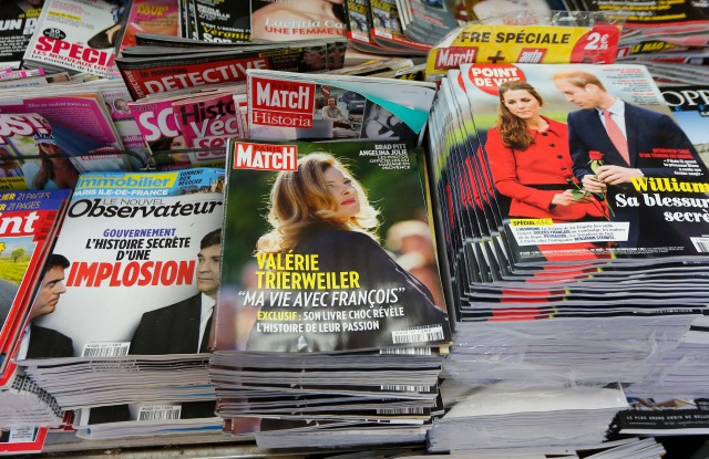 """A man buys a copy of Paris Match news magazine, in a Paris newsstand, with a photo of Valerie Trierweiler on the cover and the lead """"My life with Francois"""". Former French first lady Valerie Trierweiler's book """"Merci pour ce moment"""" (Thanks for this moment) relates her life at the presidential palace and will go on sale ThursdayFrance President Sex Life, Paris, France"""