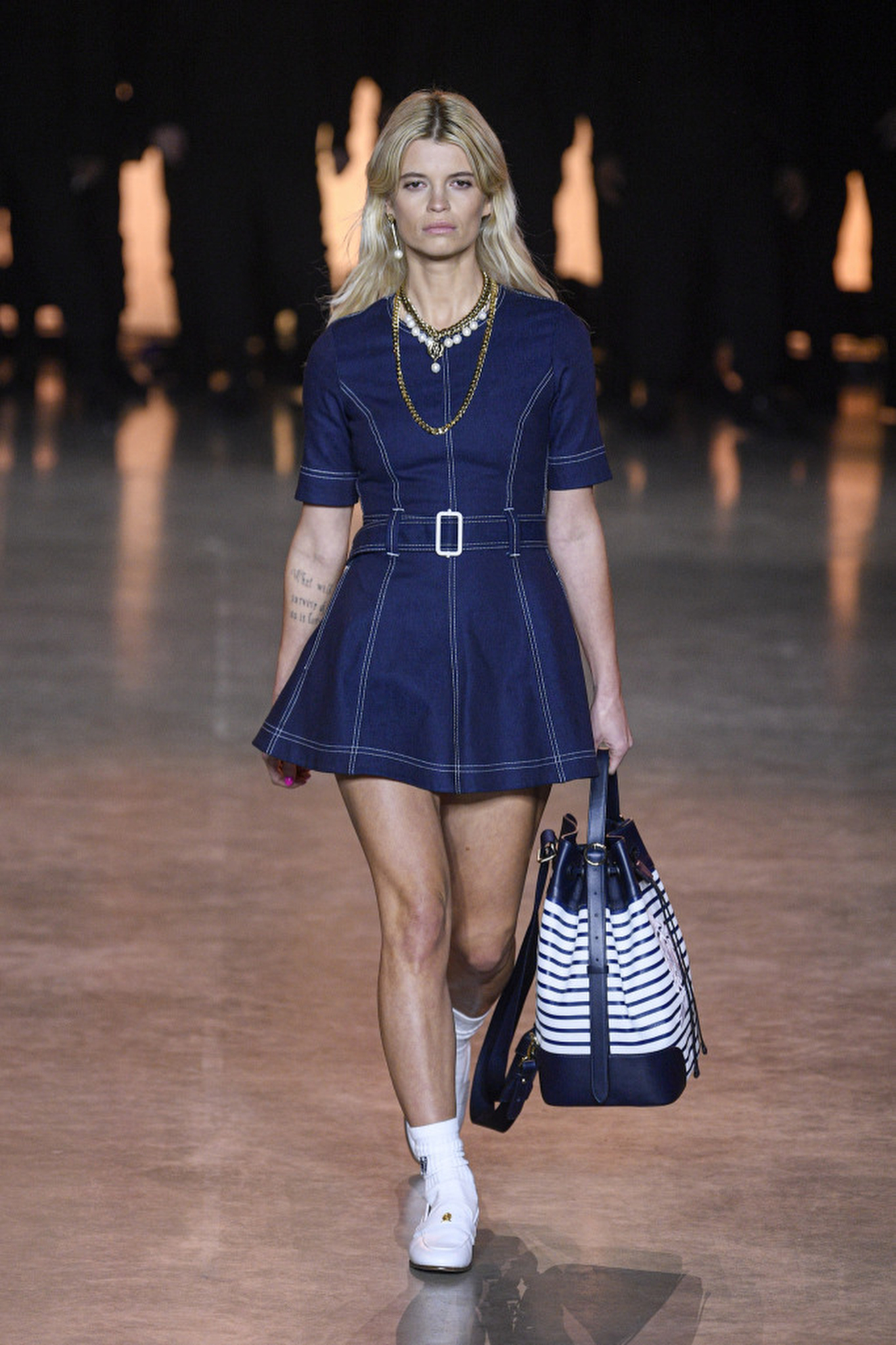 At Tommy Hilfiger, short and sassy took a polished turn, finished off with ladylike pearls.
