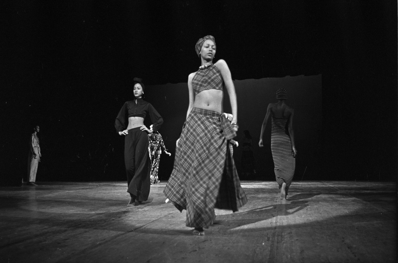 Models dressed in midriff-bearing tops and oversized bottoms of solids, stripes and plaids worn with headresses during the fashion show to benefit the restoration of the Chateau of Versailles, five American designers matching talents with five French couturiers at the Versailles Palace on November 28, 1973 in Versailles, France...Article title:'One night and pouf! It's gone!Battle of Versailles, Versailles