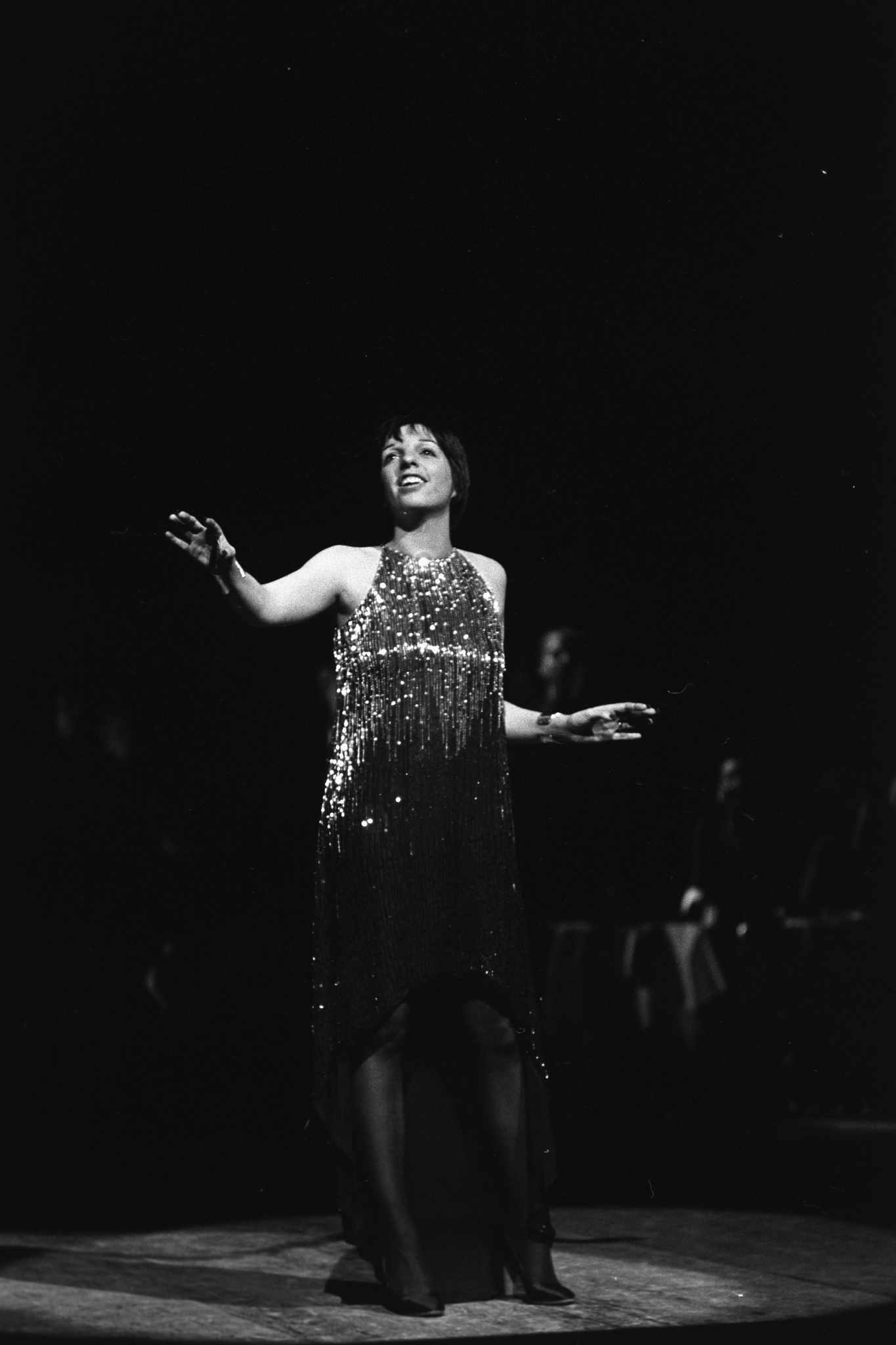 Liza Minnelli performs during the fashion show to benefit the restoration of the Chateau of Versailles, five American designers matching talents with five French couturiers at the Versailles Palace on November 28, 1973 in Versailles, France...Article title: 'One night and pouf! It's gone!Battle of Versailles, Versailles