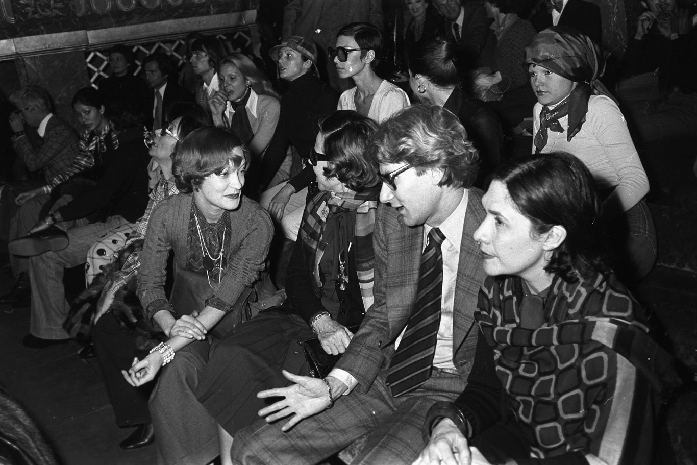 Yves Saint Laurent, Loulou de la Falaise and friends attend the fashion show to benefit the restoration of the Chateau of Versailles, five American designers matching talents with five French couturiers at the Versailles Palace on November 28, 1973 in Versailles, France...Article title: 'One night and pouf! It's gone!Battle of Versailles, Versailles
