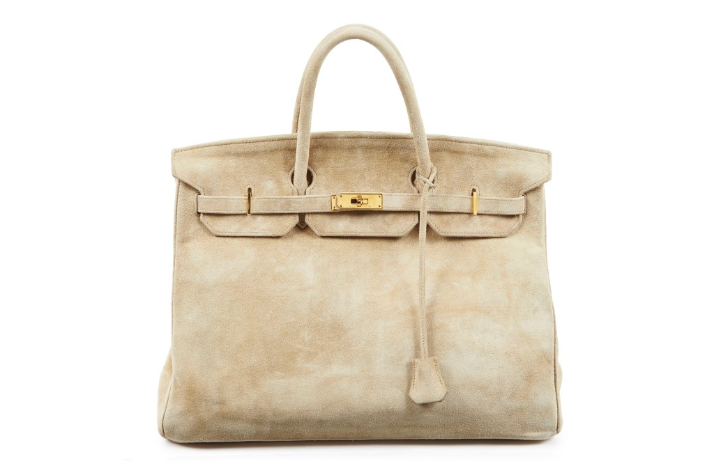 A 1986 Birkin bag in beige Veau Doblis suede with gold-plated hardware.