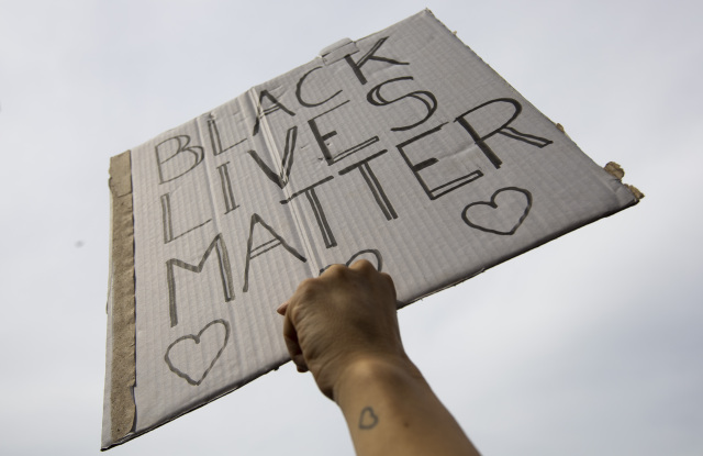 People take part in a Black Lives Matter protest in Amsterdam, Netherlands, to protest against the recent killing of George Floyd, a black man who died in police custody in Minneapolis, U.S.A., after being restrained by police officers on Memorial DayAmerica Protests , Amsterdam, Netherlands - 01 Jun 2020