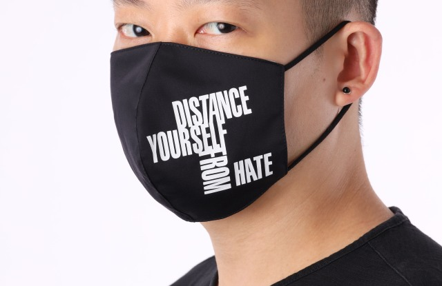 """Jason Wu wearing the """"Distance Yourself From Hate"""" mask."""