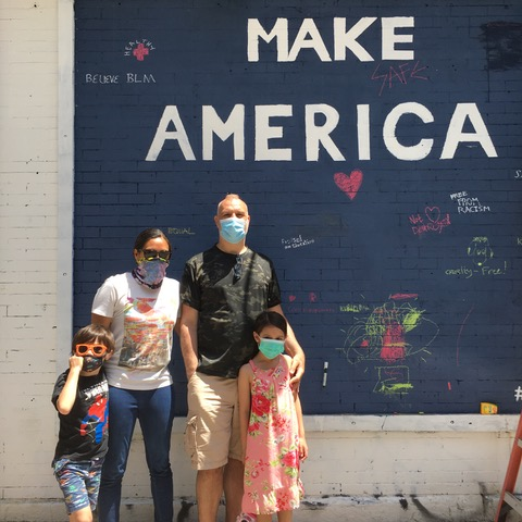 "The ""Make America"" chalkboard mural outside Quality Mending in New York City."