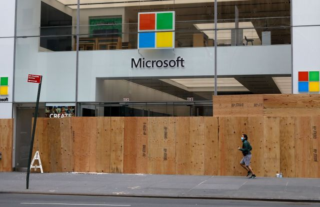 A man jogs past the Microsoft Flagship store boarded up windows on Fifth Avenue after looting riots a night earlier as part of the response by protesters to George Floyd's death, in New York, New York, USA, 02 June 2020. A bystander's video posted online on 25 May, shows George Floyd pleading with arresting officers that he couldn't breathe as an officer knelt on his neck. The unarmed black man soon became unresponsive, and was later pronounced dead. According to reports on 29 May, Derek Chauvin, the police officer at the center of the incident, has been taken into custody and charged with murder in the death of George Floyd.Looting Clean-up New York, USA - 02 Jun 2020