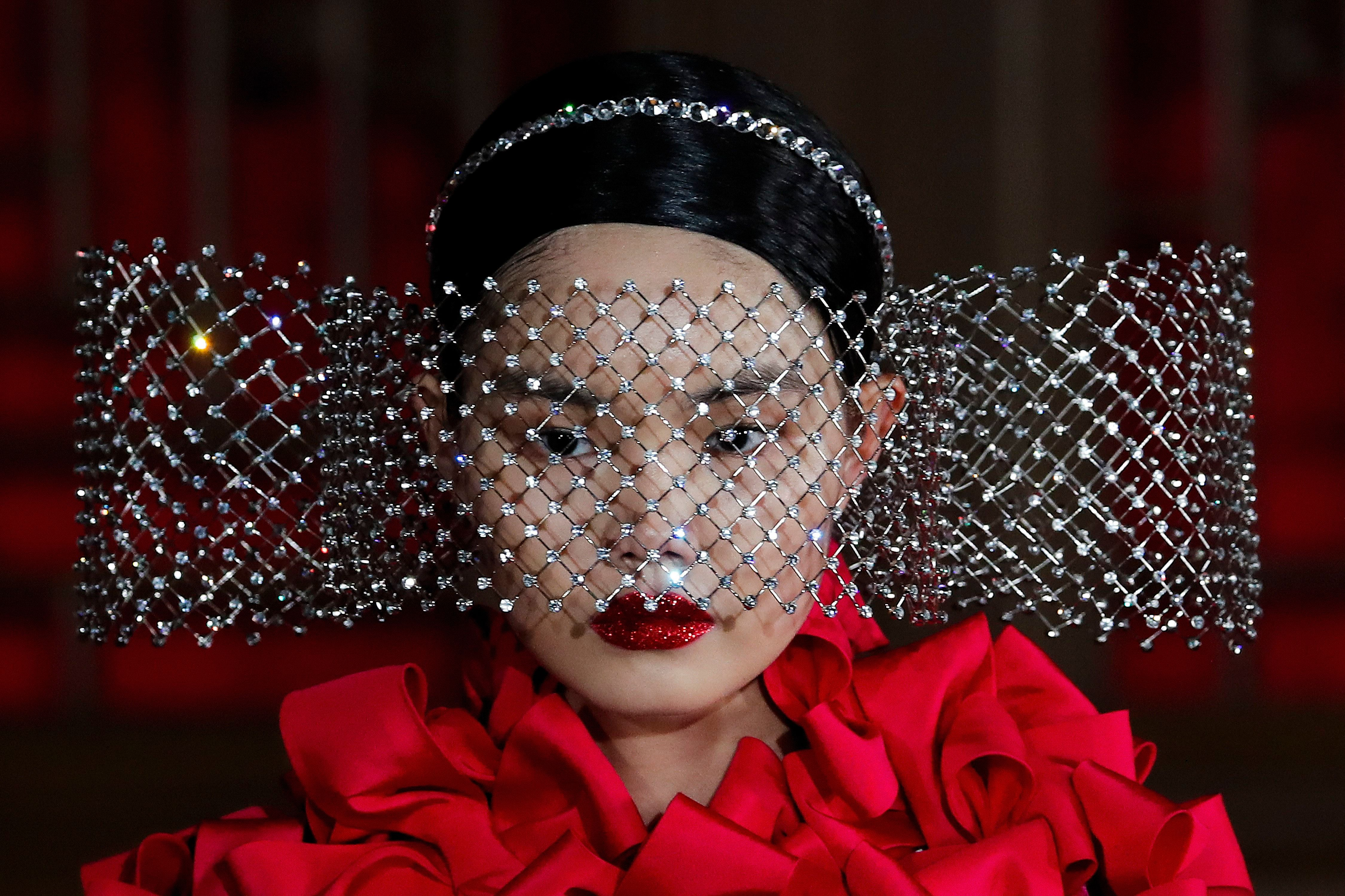 A model presents a creation from Valentino Haute Couture collection by designer Pierpaolo Piccioli during a fashion show at the Aman Summer Palace in Beijing.