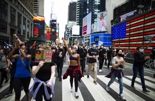 Protesters march in times square