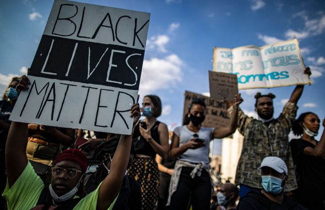 Protesters take part in a demonstration to protest in support of the George Floyd protests in the United States, and also to commemorate a similar circumstance in France when Adama Traore, a 24 year old old black Frenchman who was killed in 2016 by police, during an illegal rally in front of the new courthouse in Paris, France, 02 June 2020.Protest in Paris against US police brutality, France - 02 Jun 2020