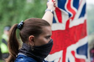 An anti-racism protester holds up a Union Flag in Huddersfield.Protests in Huddersfield, UK - 13 Jun 2020
