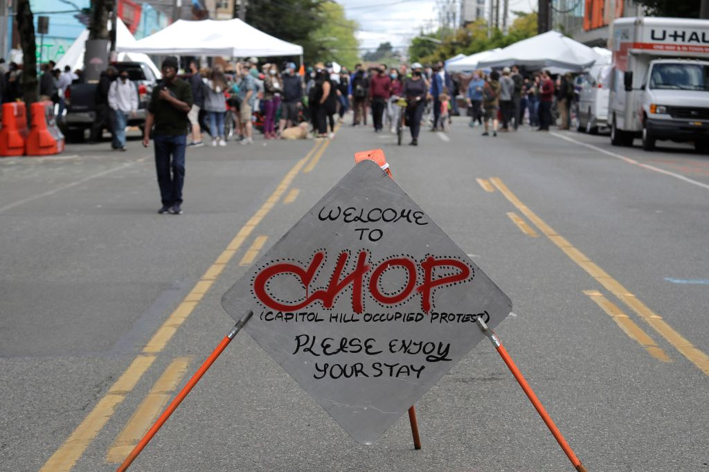 """Sign reads """"Welcome to CHOP,"""", inside what has been named the Capitol Hill Occupied Protest zone in Seattle. Protesters calling for police reform and other demands have taken over several blocks near downtown Seattle after officers withdrew from a police station in the area following violent confrontations. The CHOP name is a change from CHAZ (Capitol Hill Autonomous Zone) that was used earlier in the weekAmerica Protests Demonstrations, Seattle, United States - 14 Jun 2020"""