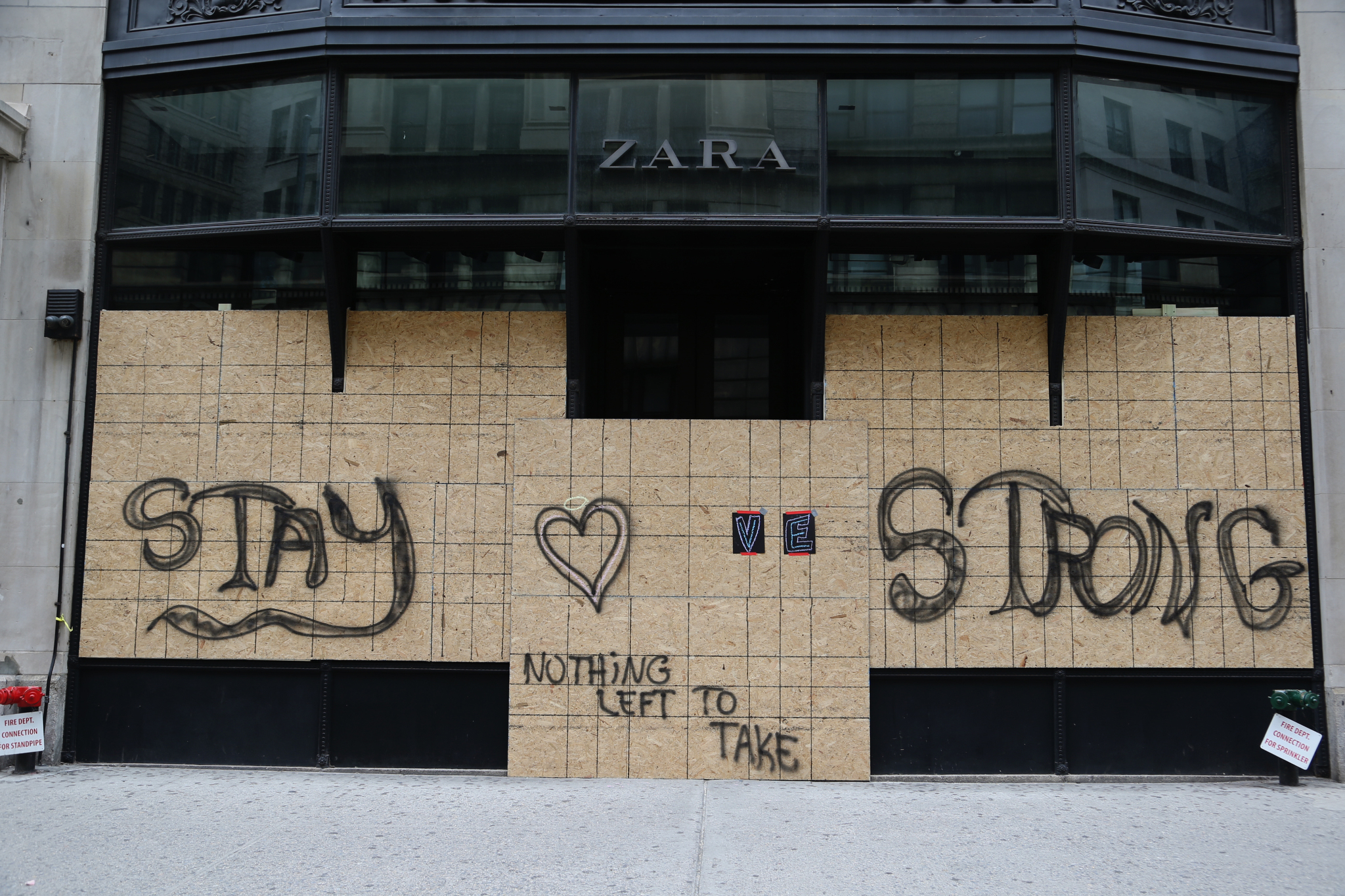 A boarded up Zara in New York.