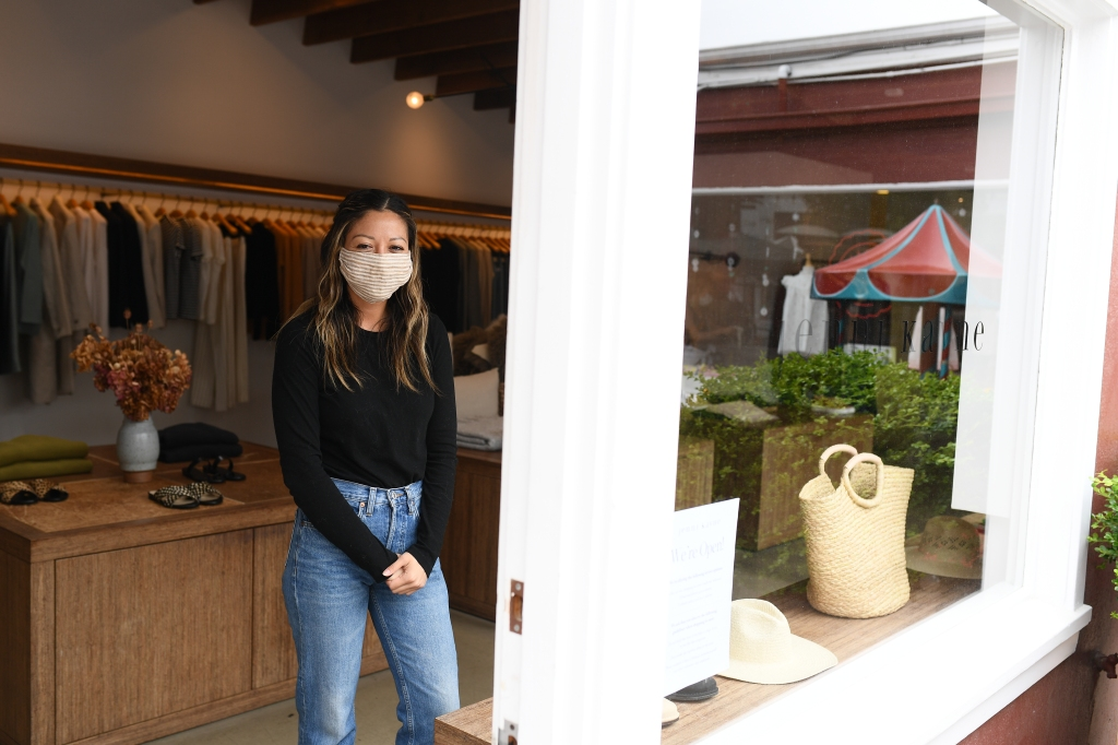 Jacqueline Tojin works at the Jenni Kayne store at the Brentwood Country Mart store on May 28, 2020 in Brentwood California.