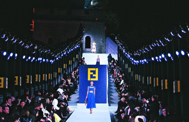 Arguably one of today's most Teflon-coated industries, fashion continues its global advance at breakneck speed, seemingly immune to any geographic, nationalist, political, religious or moral barriers., Fashion show by Fendi being held on the Great Wall of China, at night.