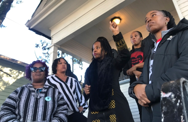 In this photo taken Dec. 30, 2019, Sharena Thomas, left, Carroll Fife, center, Dominique Walker, second from right, and Tolani KIng, right, stand outside a vacant home on Magnolia Street in West Oakland, Calif. The group Moms 4 Housing is fighting an eviction after occupying the house since November. The women took over the home after they said they were unable to find permanent housing in the Bay Area, where high-paying tech jobs have exacerbated income inequality and a housing shortage. (Kate Wolffe/KQED via AP)